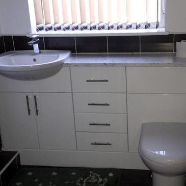 bathroom sink, toilet and cupboards